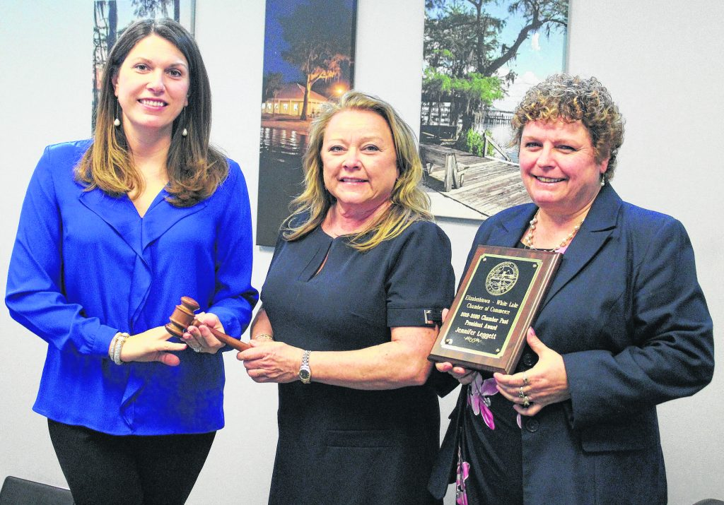 Jennifer Leggett was presented a plaque for serving as the 2019-2020 Chamber President. She is seen here hanfing the President gavel to Anne Beyers.