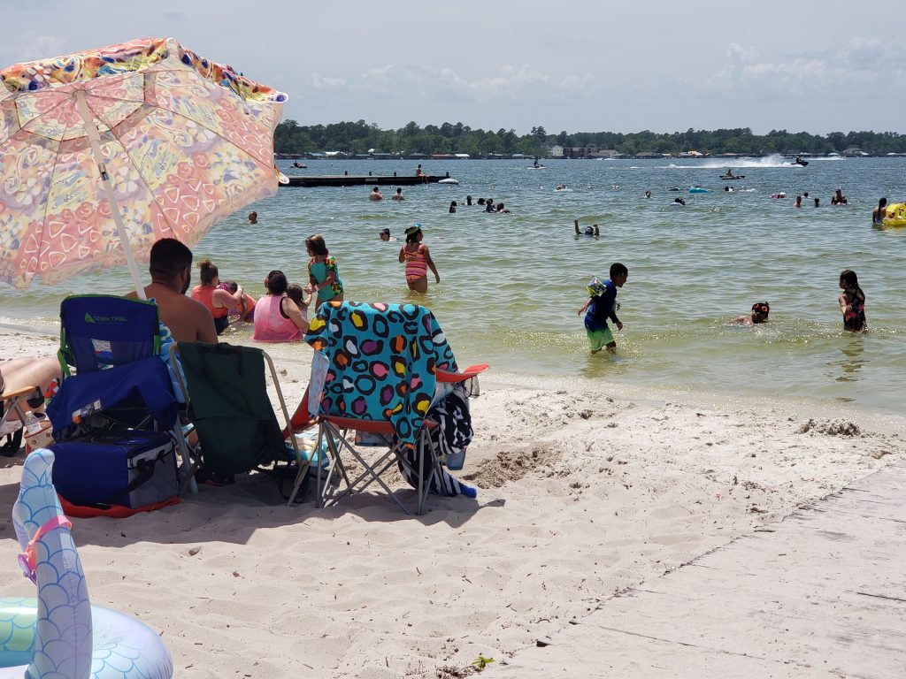 Families playing at Goldston's Beach